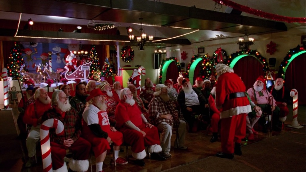 A room full of Santas being trained to laugh