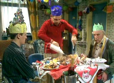 Scene from Christmas Crackers of Del Boy carving turkey for himself, Rodney and Grandad