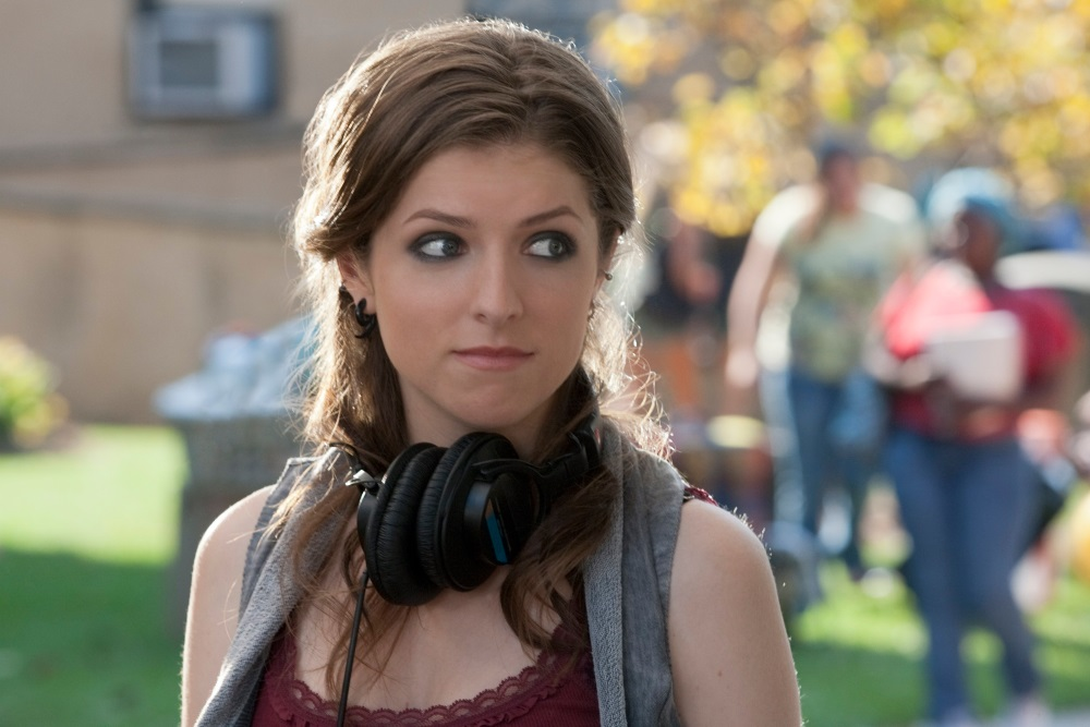 Picture of Beca in Pitch Perfect wearing a pair of headphones